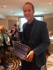 Travis Stanton of EXHIBITOR magazine shows off his Upper Midwest Regional Azbees
